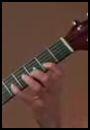 Image-manche-guitare-avec-doigts-sur-cordes